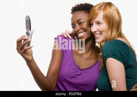 Friends photographing themselves with cell phone - Stock Photo