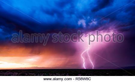 Lighting strike during sunset southeast of Safford, Graham County, Arizona, USA on June 29th 2018 - Stock Photo