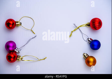 six multi-colored balls on a light background. Christmas composition, winter season. For your design. - Stock Photo