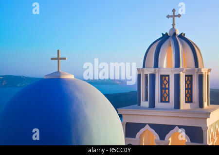Bell Towers of Orthodox Church overlooking the Caldera in Fira, Santorini (Thira), Cyclades Islands, Greece - Stock Photo