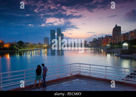 Kazakhstan, Astana, Couple looking at city view from banks of Ishim River - Stock Photo