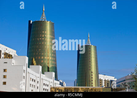 Kazakhstan, Astana, House of Ministries and twin golden conical business centres the southern one contains the headquarters of Samruk-Kazyna Kazakhstan's sovereign wealth fund - Stock Photo