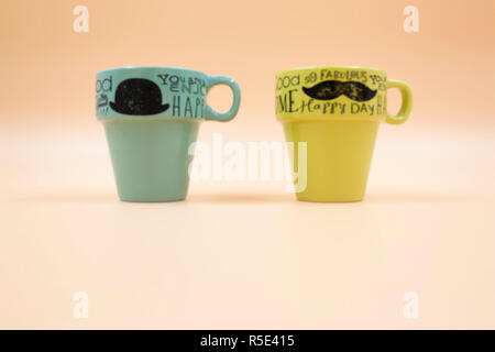 macro set detail of two empty cups of coffee with different color message - Stock Photo