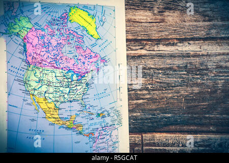 atlas page North America continent retro map with wooden vintage background - Stock Photo