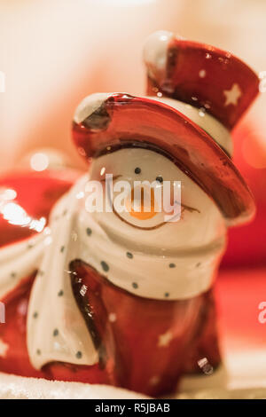 close up of a snowman figure in a santa claus costume, xmas - Stock Photo