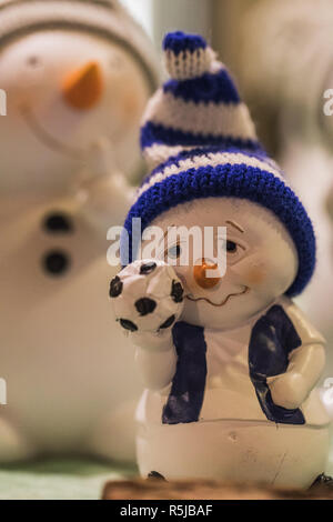 close up of two snowman figures standing under christmas tree, xmas - Stock Photo