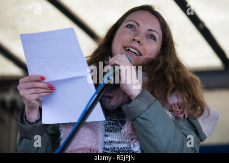 London, UK. 1st December, 2018. A Polish climate campaigner addresses the Together for Climate Justice demonstration against Government policies in relation to climate change, including Heathrow expansion and fracking. Following a rally outside the Polish embassy, chosen to highlight the UN's Katowice Climate Change Conference which begins tomorrow, protesters marched to Downing Street. Credit: Mark Kerrison/Alamy Live News - Stock Photo