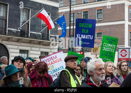 London, UK. 1st December, 2018. A placard bearing a message in Polish is held by environmental campaigners outside the Polish embassy during a Together for Climate Justice demonstration in protest against Government policies in relation to climate change, including Heathrow expansion and fracking. Following a rally outside the Polish embassy, chosen to highlight the UN's Katowice Climate Change Conference which begins tomorrow, protesters marched to Downing Street. Credit: Mark Kerrison/Alamy Live News - Stock Photo