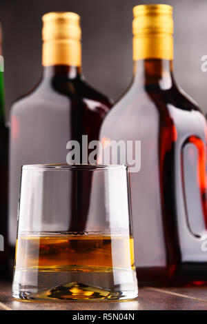 Composition with glass and bottles of hard liquor - Stock Photo