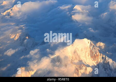Aerial view of Mont Blanc (4,808.7 m / 15,777 ft). The highest mountain in the Alps sunlit at dusk. - Stock Photo