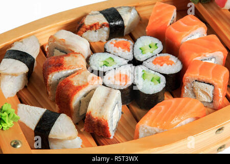 Set of sushi rolls on a wooden ship. Creative serving dishes. Menu. - Stock Photo