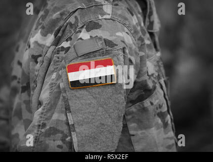 Flag of Yemen on soldiers arm (collage). - Stock Photo