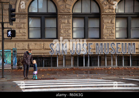 A mother and daughter stand outside of the San Jose Museum of Art. - Stock Photo