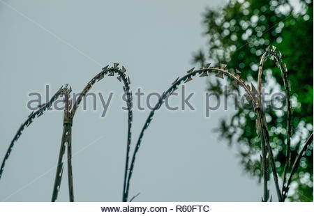 Portable barrier of sword blades. Barricades on the stone wall. - Stock Photo