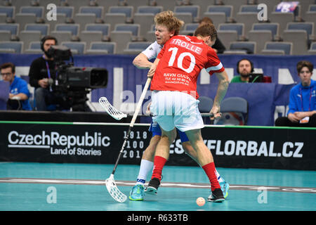 Prague, Czech Republic. 03rd Dec, 2018. Left to right floorball players JOONAS PYLSY (FIN) and JANNIK WEDE TROLLE (DK) in action during the Men's World Floorball Championship group B match Finland vs. Denmark in Prague, Czech Republic, December 3, 2018. Credit: Michal Kamaryt/CTK Photo/Alamy Live News - Stock Photo