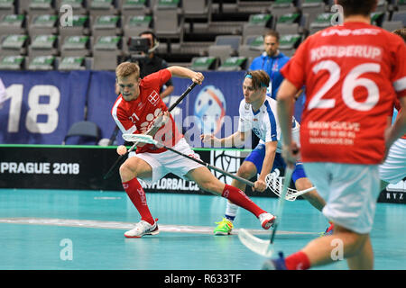 Prague, Czech Republic. 03rd Dec, 2018. Left to right floorball players ESBEN KOHLER (DK) and PETER KOTILAINEN (FIN) in action during the Men's World Floorball Championship group B match Finland vs. Denmark in Prague, Czech Republic, December 3, 2018. Credit: Michal Kamaryt/CTK Photo/Alamy Live News - Stock Photo