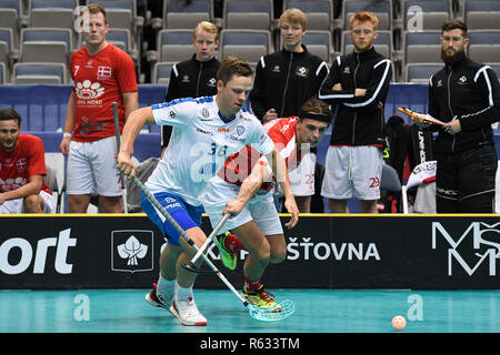 Prague, Czech Republic. 03rd Dec, 2018. Left to right floorball players VILLE LASTIKK (FIN) and JESPER SCHMIDT (DK) in action during the Men's World Floorball Championship group B match Finland vs. Denmark in Prague, Czech Republic, December 3, 2018. Credit: Michal Kamaryt/CTK Photo/Alamy Live News - Stock Photo