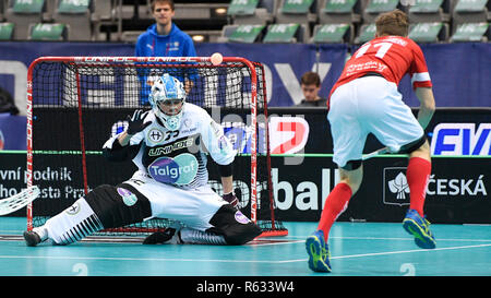 Prague, Czech Republic. 03rd Dec, 2018. Left to right floorball players LASSI TORISEVA (FIN) and SIMON LAURIDSEN (DK) in action during the Men's World Floorball Championship group B match Finland vs. Denmark in Prague, Czech Republic, December 3, 2018. Credit: Michal Kamaryt/CTK Photo/Alamy Live News - Stock Photo
