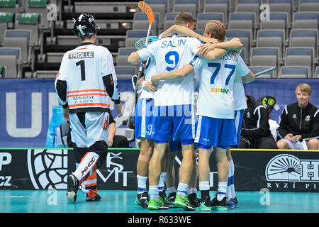 Prague, Czech Republic. 03rd Dec, 2018. Finnish floorball players celebrate a goal during the Men's World Floorball Championship group B match Finland vs. Denmark in Prague, Czech Republic, December 3, 2018. At left is goalie MIKE TROLLE of Denmark. Credit: Michal Kamaryt/CTK Photo/Alamy Live News - Stock Photo