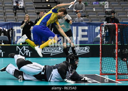 Prague, Czech Republic. 03rd Dec, 2018. Left to right floorball players in action during the Men's World Floorball Championship group B match Sweden vs. Norway in Prague, Czech Republic, December 3, 2018. Credit: Michal Kamaryt/CTK Photo/Alamy Live News - Stock Photo