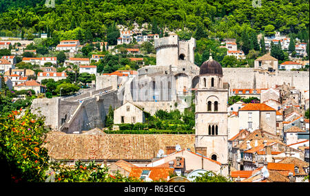 Bell tower of Franciscan Monastery and Minceta Tower in Dubrovnik, Croatia - Stock Photo