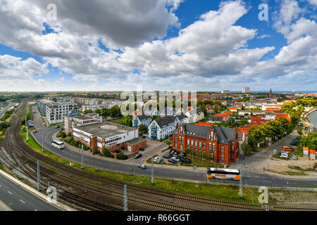 View of the city, Baltic Sea, and old town in the coastal port city of Warnemunde, Rostock, Germany. - Stock Photo