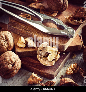 Fresh walnuts on an old wooden table - Stock Photo