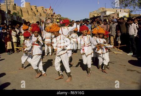 children performing folk dance in jaisalmer dance festival, rajasthan, india - Stock Photo