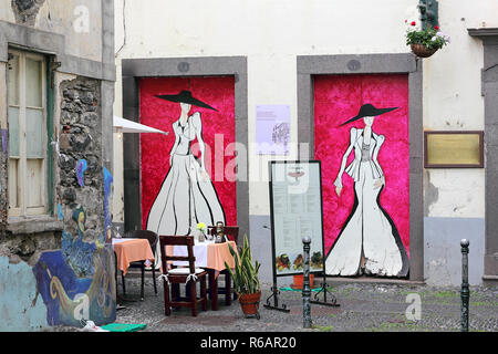 Art of open doors in the Santa Maria street in the old city of Funchal, Madeira - Stock Photo