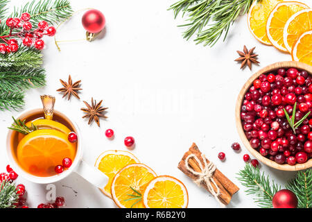 Christmas fruit tea from cranberry, rosemary, orange and anise o - Stock Photo