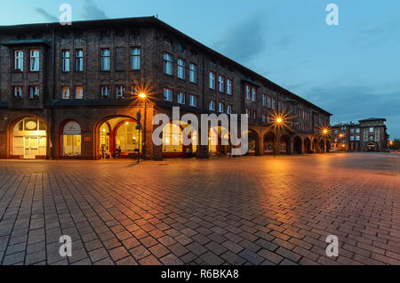 Square and houses in historic Nikiszowiec district in Katowice, Poland. - Stock Photo