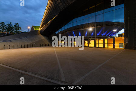 International Convention Centre in Katowice with Spodek in reflection in the evening. - Stock Photo