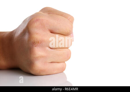Male clenched fist isolated on white background - Stock Photo