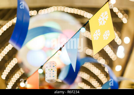 Photo of Christmas flags on blurred background - Stock Photo