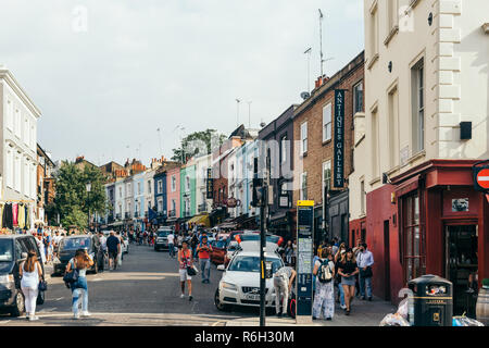 London/UK - July 21 2018: People walking on Portobello Market, one of London's notable street markets, known for its second-hand clothes and antiques - Stock Photo