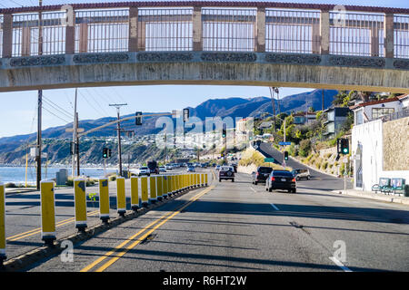December 2, 2018 Los Angeles / CA / USA - Driving on Highway 1 on the Pacific Ocean coastline; the Getty Villa visible on the right - Stock Photo