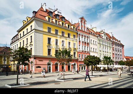 WROCLAW POLAND - August  18 2013: People visit Rynek (Market Square) in Wroclaw. Wroclaw is the 4th largest city in Poland with 632067 people (2013). - Stock Photo