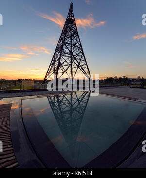 Historic radiostation tower in Gliwice and reflaction, Poland in sunset time. - Stock Photo