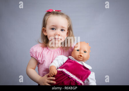 Girl with doll - Stock Photo