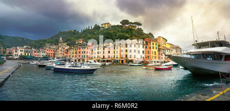 Panoramic view of picturesque harbor and Portofino resort town. Liguria, Italy - Stock Photo