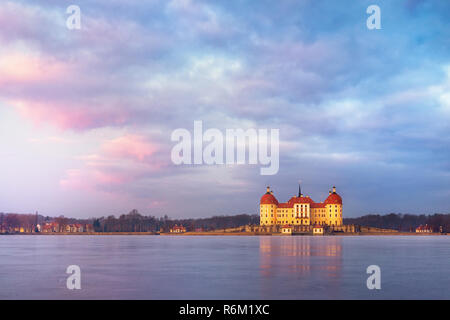 Moritzburg castle after sunrise at winter time, Germany - Stock Photo