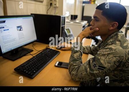 U.S. Air Force Airman 1st Class Marco Paez, 52nd Communications Squadron client systems tecnician, navigates a web page for in-processing during Spangdahlem's Eifel Pride program at Spangdahlem Air Base, Germany, May 18, 2017. During the two-week program Airmen have approximately 15 computer based trainings to complete and multiple appointments to attend in order to complete in-processing at their new duty station. - Stock Photo