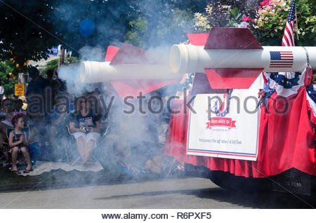BRISTOL, RHODE ISLAND - JULY 4, 2011: Smoke from rocket-powered float at Fourth of July parade in Bristol, Rhode Island - Stock Photo