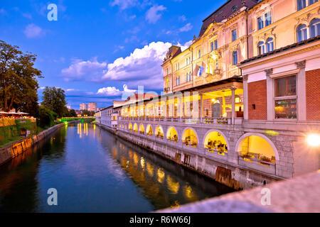 Ljubljana riverfront architecture evening view - Stock Photo