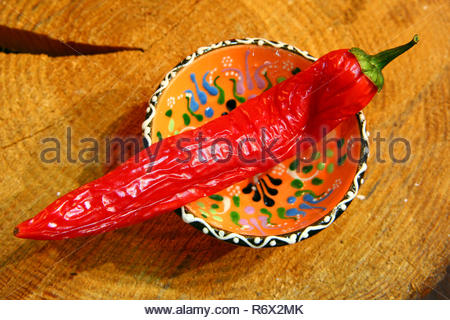 red hot chilli peppers wooden background - Stock Photo