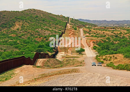 Border Fence Separating the US from Mexico Near Nogales, Arizona - Stock Photo