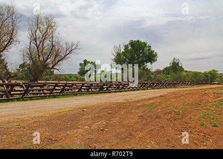 River Border Fence Separating the US from Mexico Near Nogales, Arizona - Stock Photo
