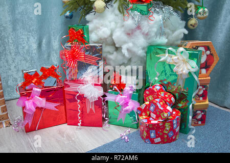 New Year background to take photo . present boxes and decorated christmas tree. gift box for xmas party. new year holiday celebration in december - Stock Photo