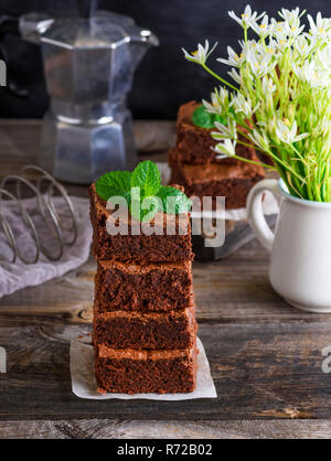 a pile of square pieces of baked brownie - Stock Photo