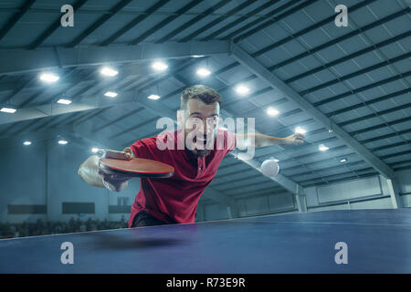 The table tennis player serving - Stock Photo